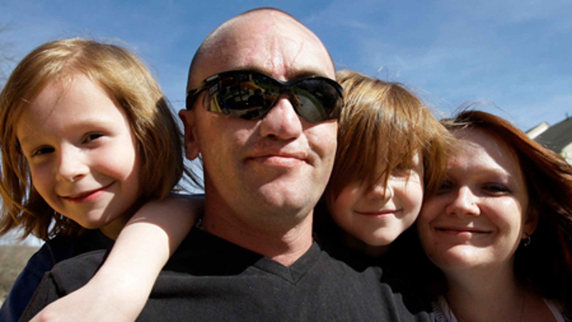 March 2, 2009: Sgt. Darron Mikeworth spends time at home with his family in San Antonio. From left are his son Ryan, 7, son Connor, 6, and wife, Dea