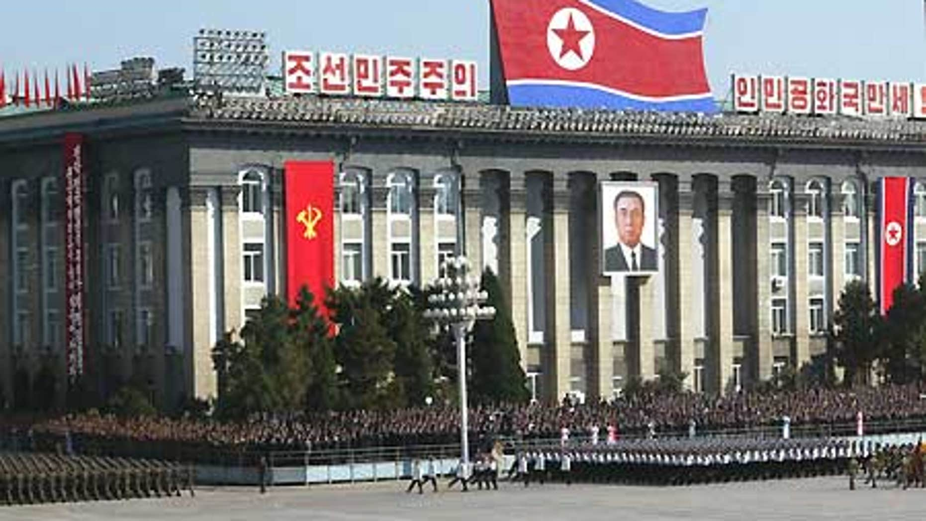 File: North Korean soldiers parade in front of Workers' Party of Korea headquarters building in Pyongyang.