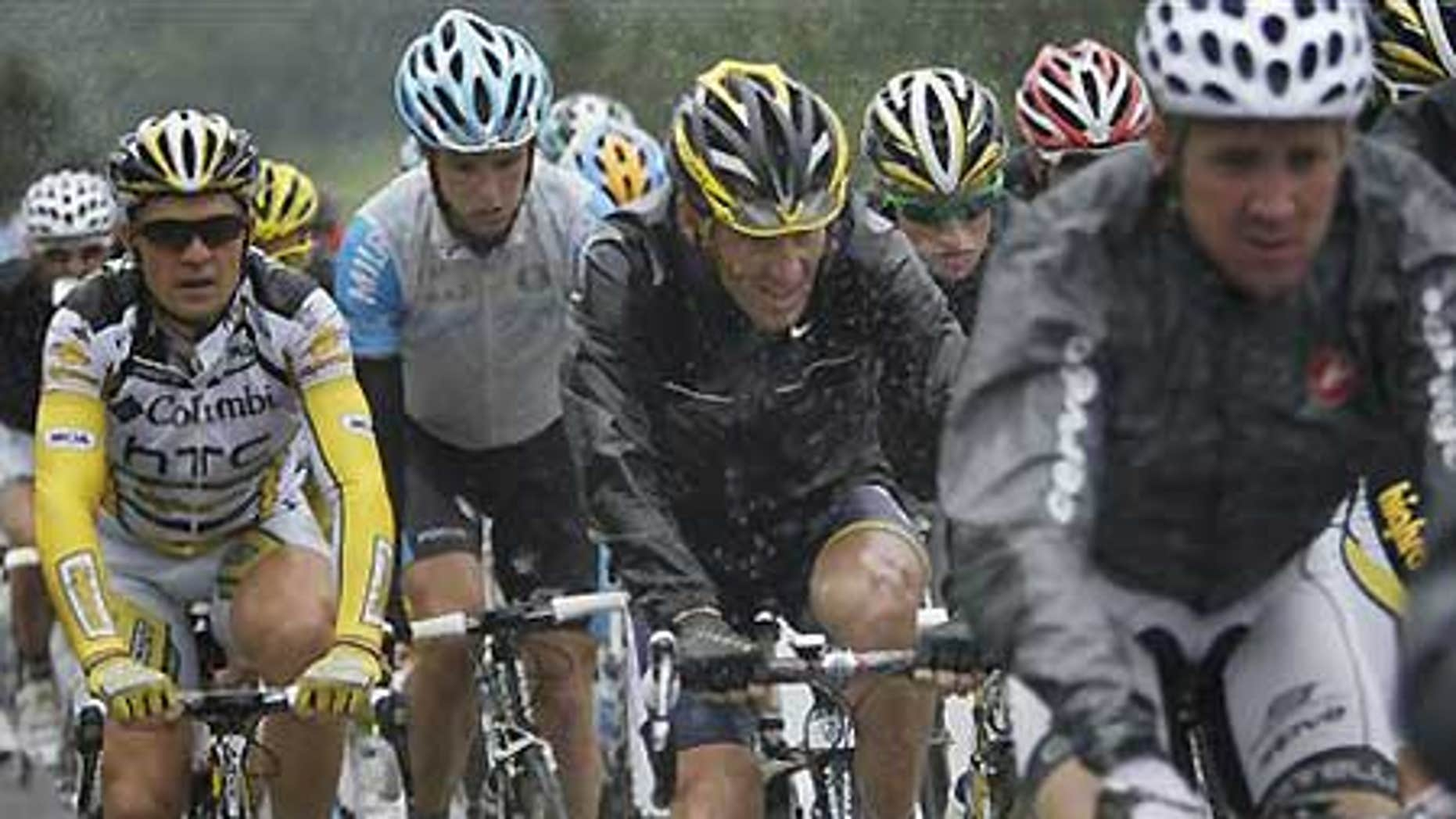 Lance Armstrong, center, in the pack during the 13th Stage of the Tour de France.