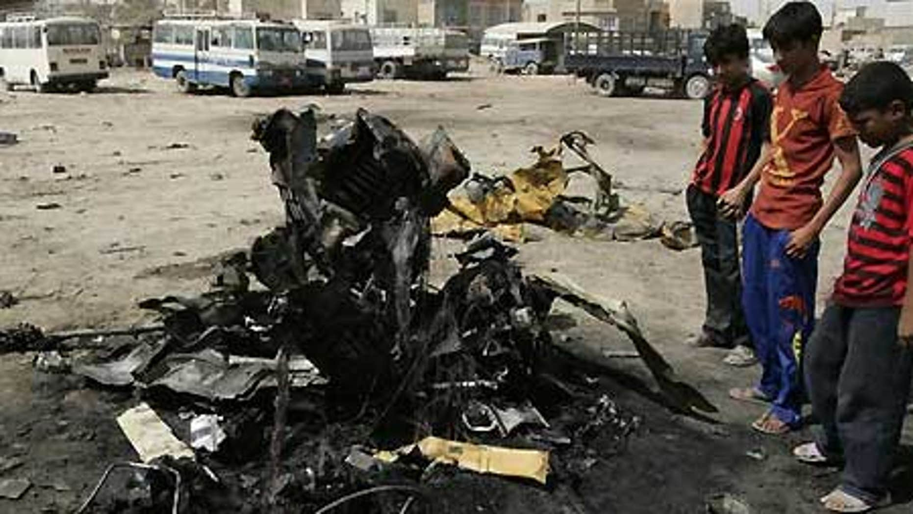July 31: Boys gather at the scene of a car bomb attack in Baghdad's Shaab District.