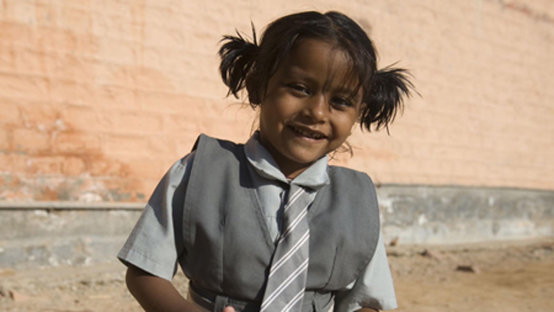 Lakshmi Tatma poses in her school uniform. She was born with four arms and four legs.