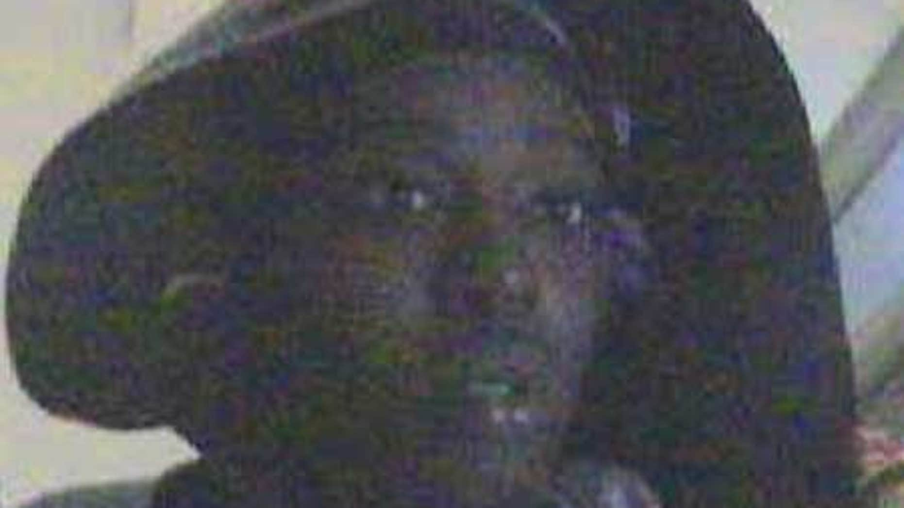 An alleged suspect in a worldwide $9M ATM scam, caught on security camera