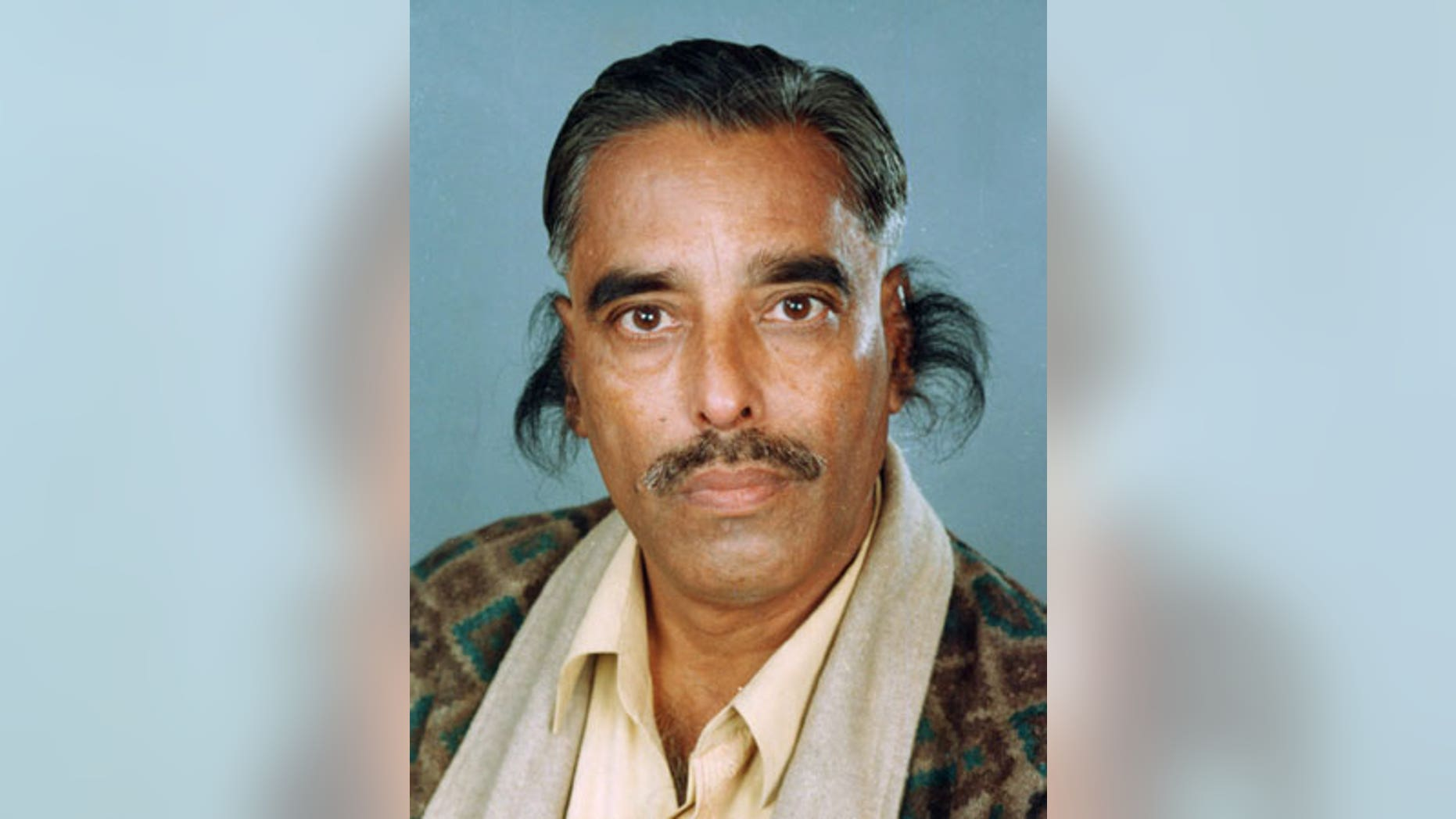 In this undated handout photograph provided by the Guinness World Records book, record holder Radhakant Bajpai is seen with his long ear hair.