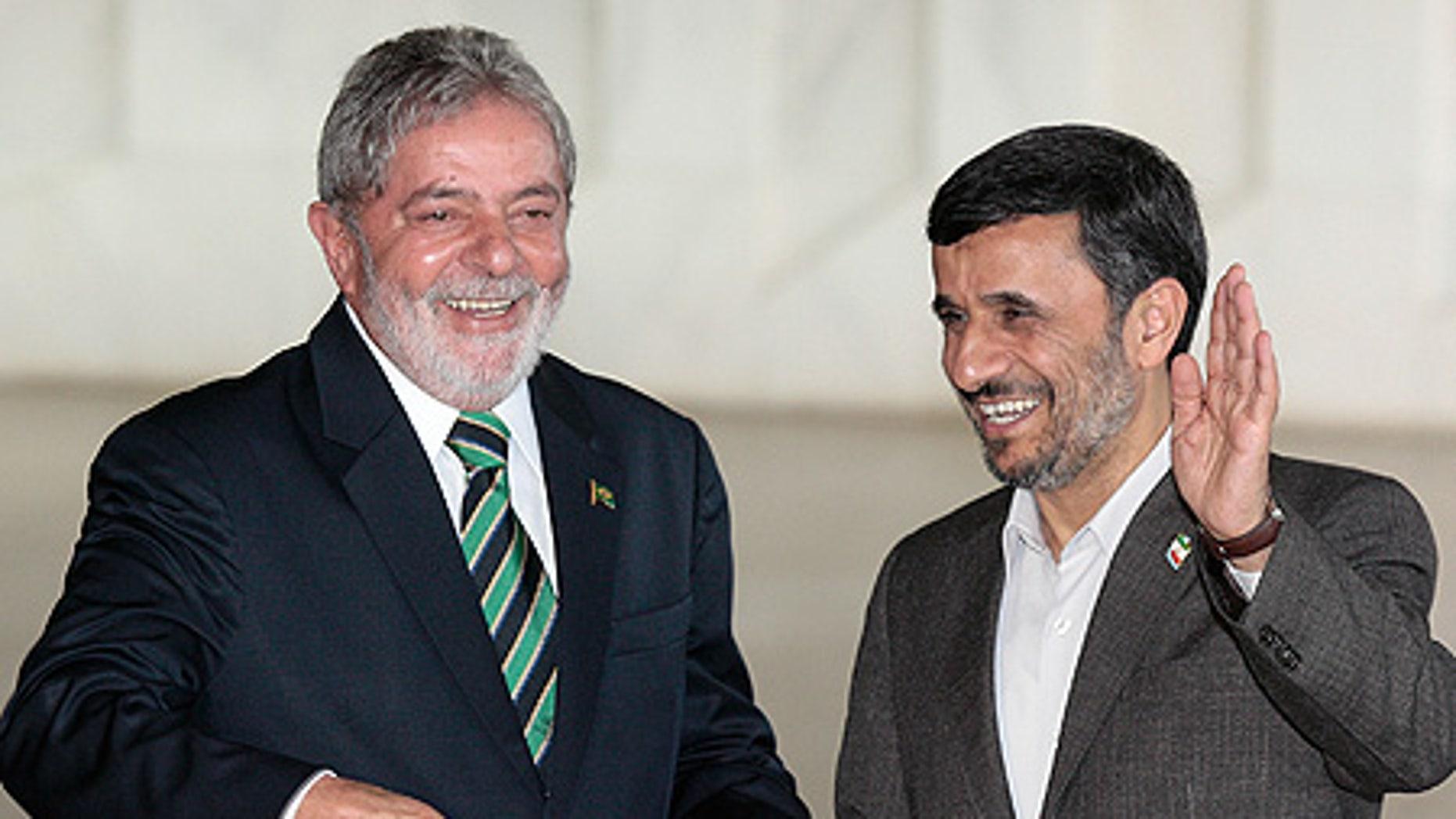 Nov. 23: Iran's President Mahmoud Ahmadinejad, right, waves as he stands with Brazil's President Luiz Inacio Lula da Silva at the Itamaraty palace.