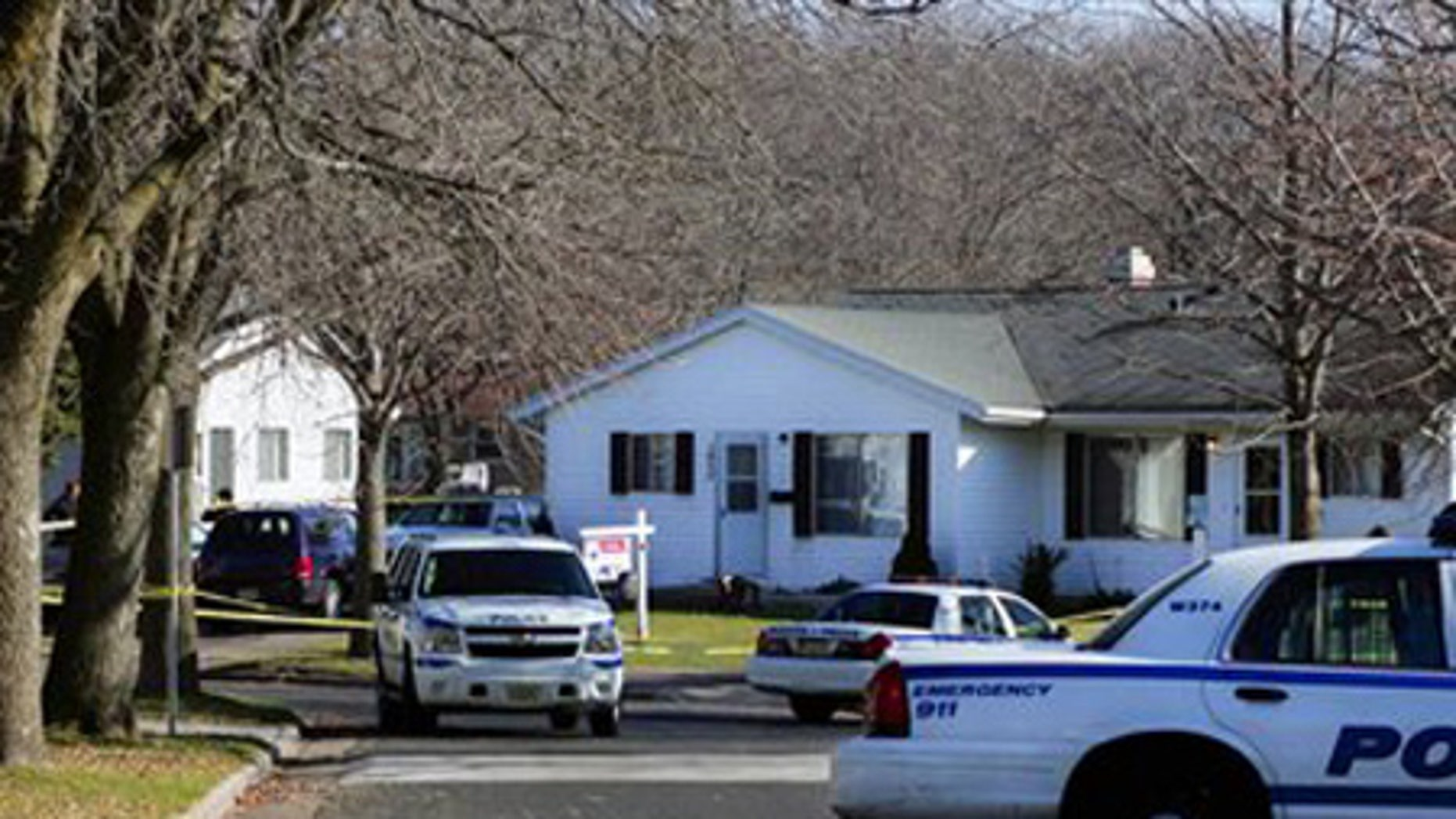 Nov. 28: Police block the intersection of Jacob's Way and Prairie Road in Madiison, Wis. for an investigation of a shooting that injured four.