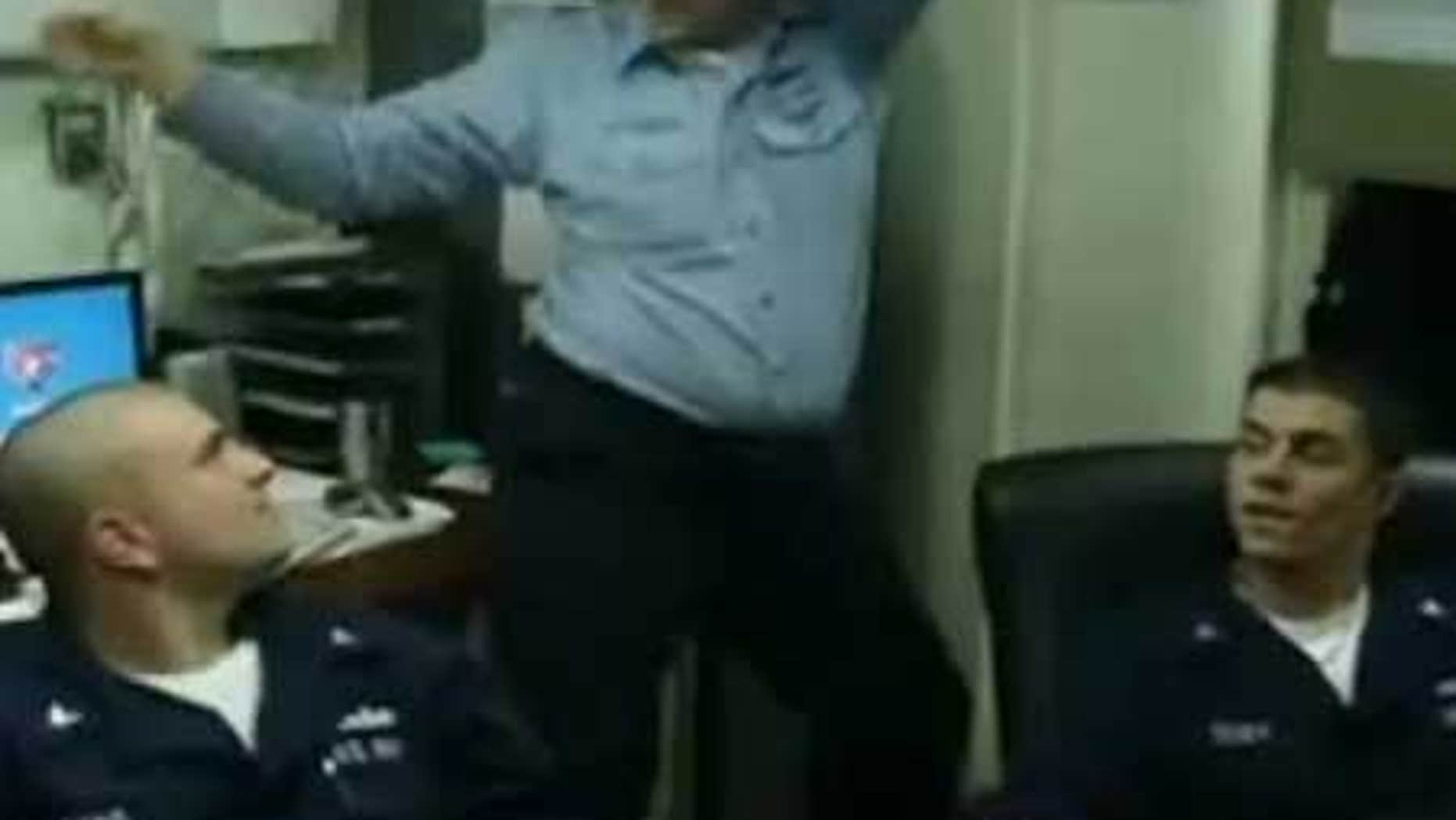 An unidentified Navy sailor, flanked by two others, dances in a YouTube video filmed by murder-suicide victim Michael Joseph Missimer.