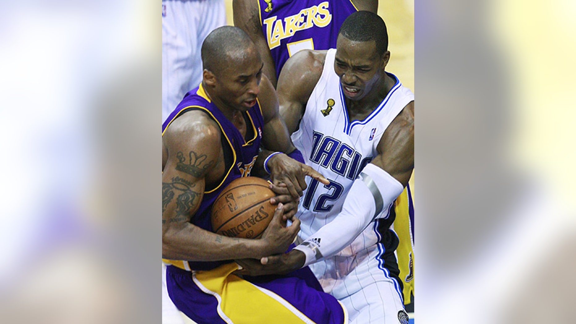 June 11: Orlando Magic's Dwight Howard (12) and Los Angeles Lakers' Kobe Bryant fight for possession in Game 4 in Orlando, Fla.