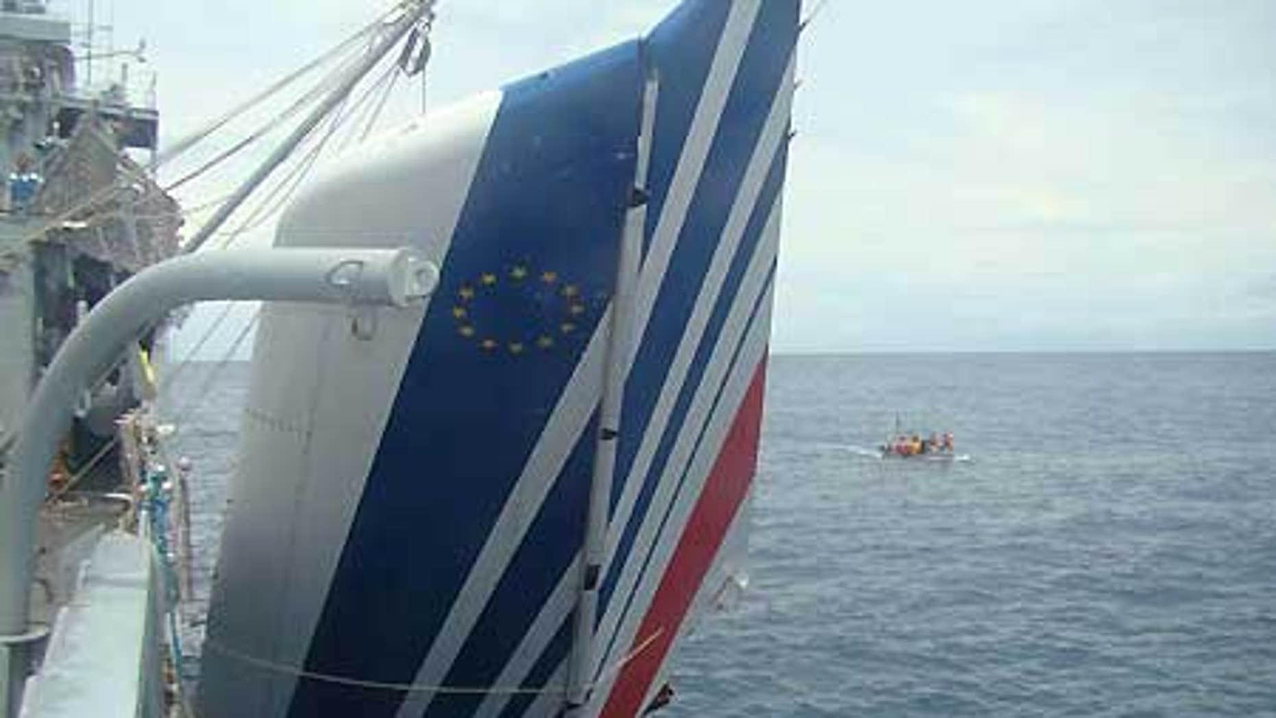 June 9: Brazil's Navy sailors recover debris of the missing Air France Flight 447 from the Atlantic Ocean.