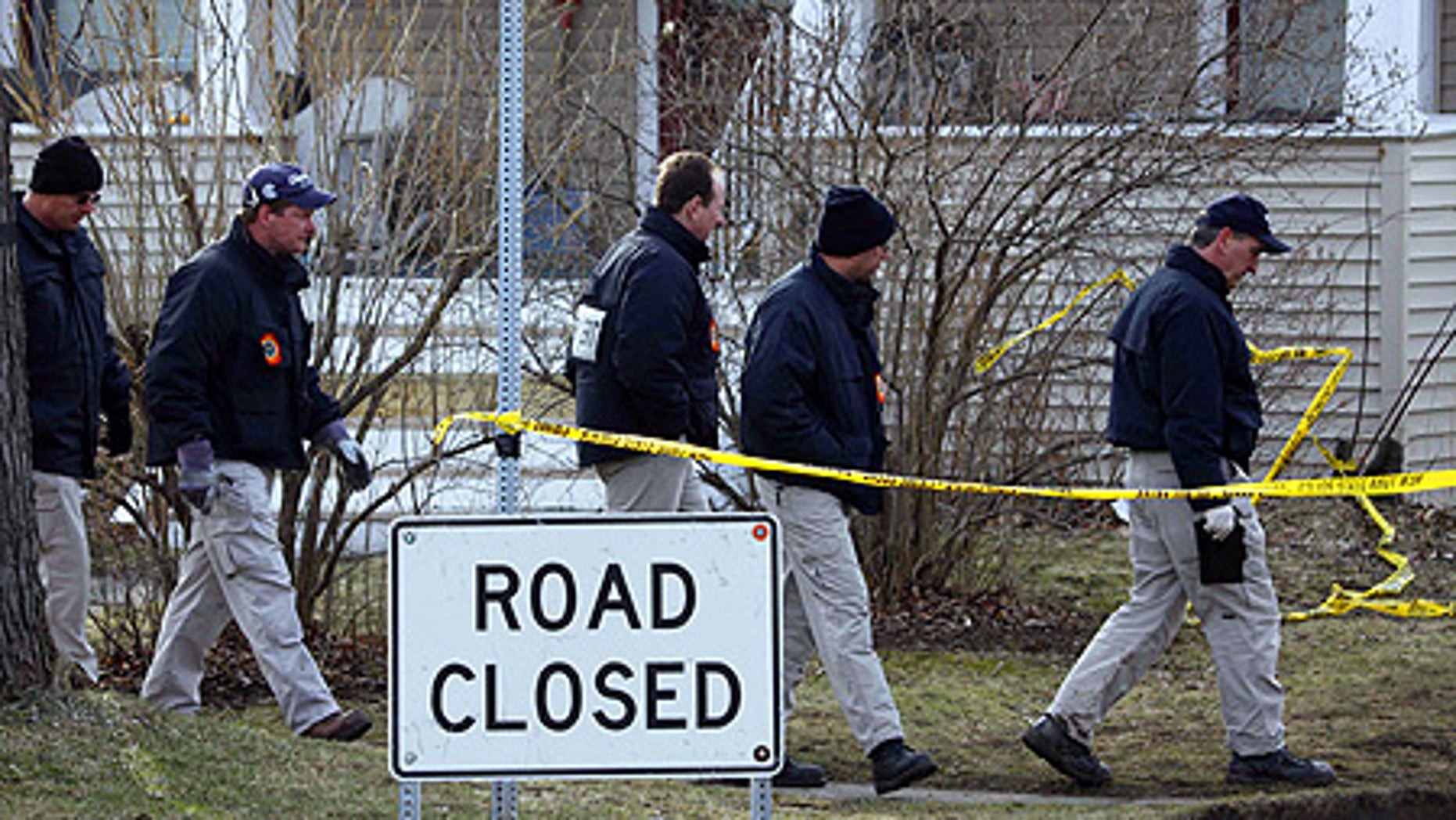 Feb. 17: FBI Evidence Response Team members search for evidence near the plane crash in Clarence Center, N.Y.