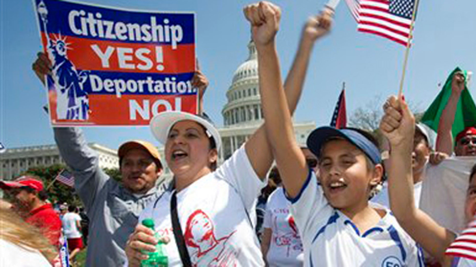 """Adita Chicas, left, and her son Jessy Chicas, 10, of Woodbridge, Va., cheer as they arrive at the """"Rally for Citizenship"""" on Capitol, Hill in Washington, Wednesday, April 10, 2013, where tens of thousands of immigrants and their supporters are expected to rally for immigration reform. Bipartisan groups in the House and Senate are said to be completing immigration bills that include a pathway to citizenship for the nation's 11 million immigrants with illegal status. (AP Photo/Jacquelyn Martin)"""