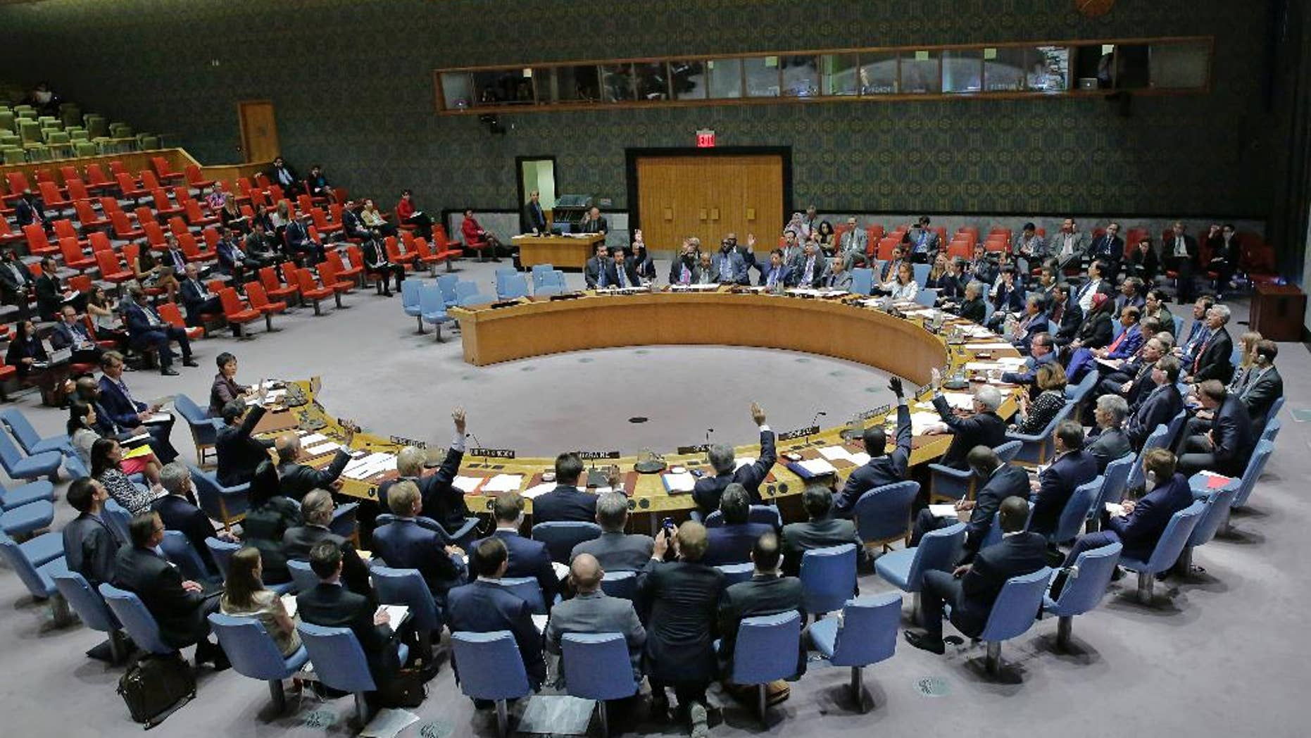 """In this photo provided by the United Nations, the U.N. Security Council unanimously adopts a resolution on aviation security and safety, Thursday, Sept. 22, 2016 at United Nations headquarters. The U.N.'s most powerful body called for stepped up screening and security checks at airports worldwide to """"detect and deter terrorist attacks."""" And it called on all countries to tighten security at airport buildings, share information about possible threats, and provide advance passenger lists so governments are aware of their transit or attempted entry. (Evan Schneider/The United Nations via AP)"""