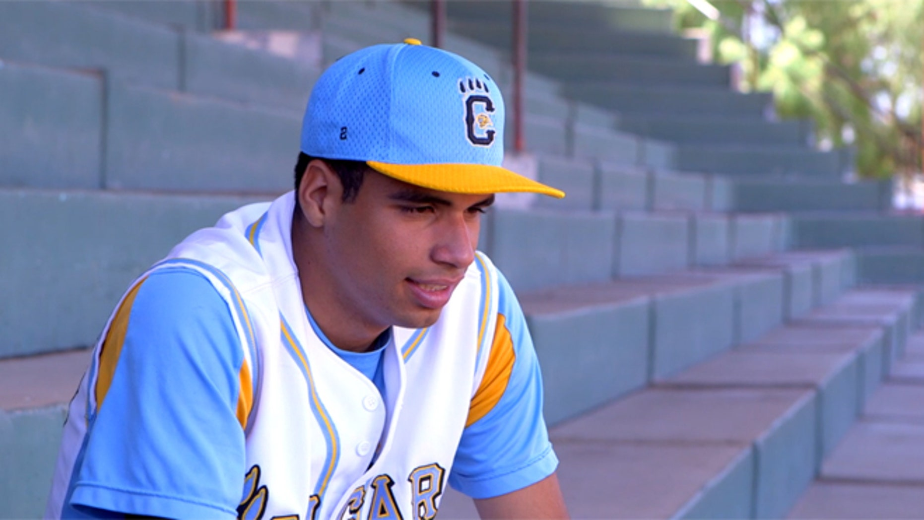 Octavio Arroyo in Tijuana, Mexico, still wearing his San Ysidro High uniform. (Source: Screen shot from ESPN)