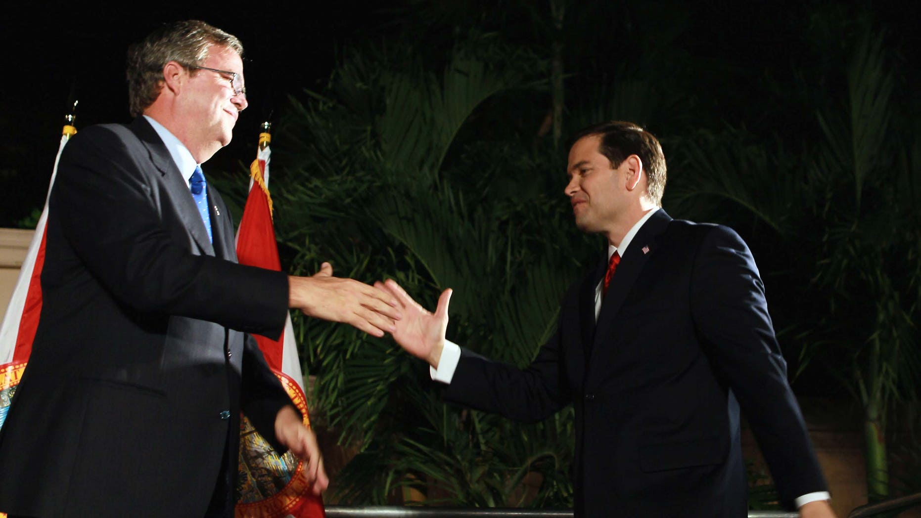 "CORAL GABELS, FL - NOVEMBER 02:  Republican nominee for Florida U.S. Senator Marco Rubio (R) is greeted by former Governor of Florida Jeb Bush during his ""Reclaim America Victory Celebration"" at the Biltmore Hotel on November 2, 2010 in Coral Gables, Florida. Results show that Rubio has clinched the Florida Senate seat against his opponents, Independent candidate and Florida Gov. Charlie Crist and Democratic candidate Rep. Kendrick Meek (D-FL).  (Photo by Joe Raedle/Getty Images) *** Local Caption *** Marco Rubio;Jeb Bush"