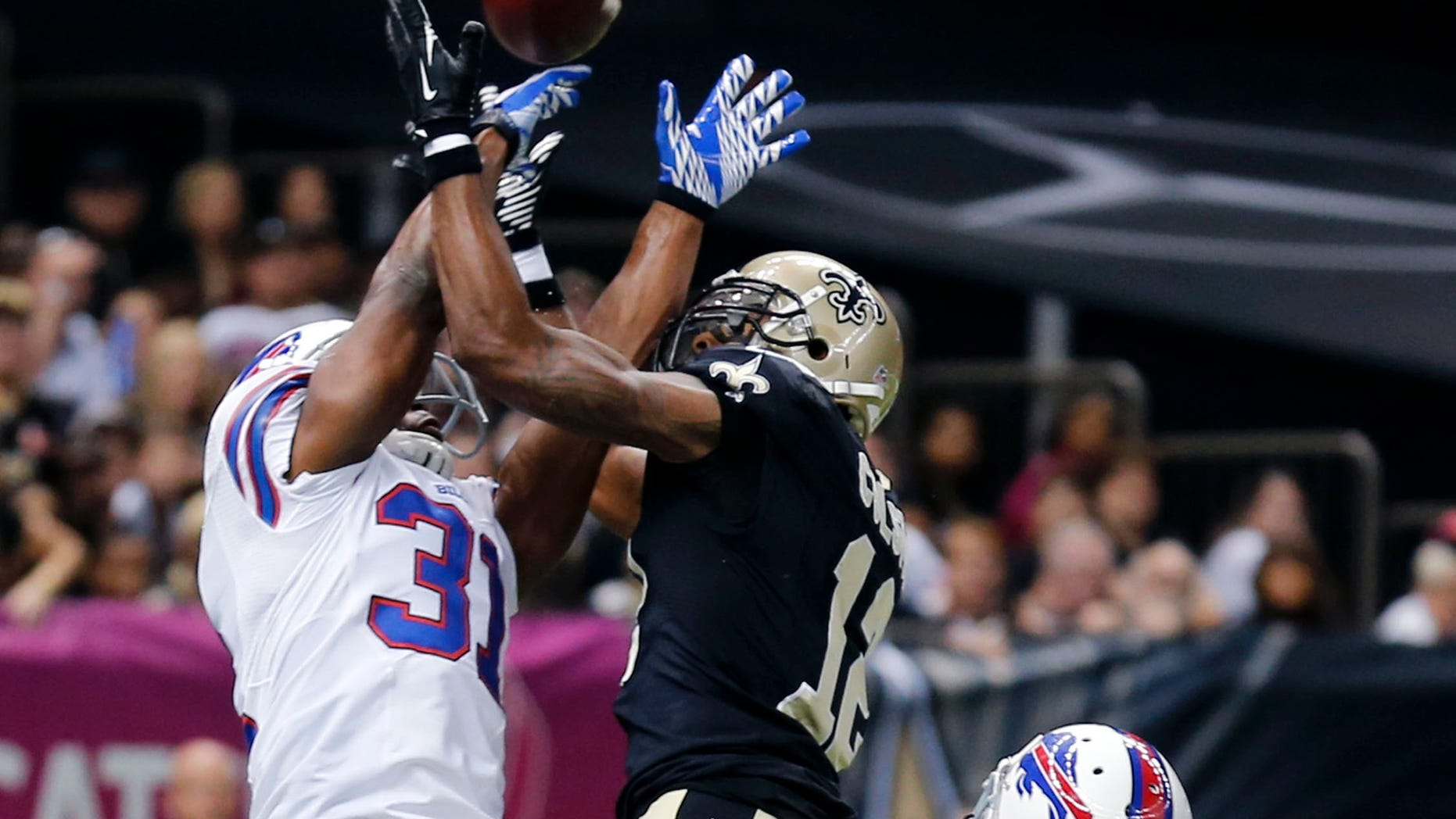 Buffalo Bills free safety Jairus Byrd (31) and defensive back Nickell Robey (37) break up a pass intended for New Orleans Saints wide receiver Marques Colston (12) during the first half of an NFL football game in New Orleans, Sunday, Oct. 27, 2013. (AP Photo/Bill Haber)