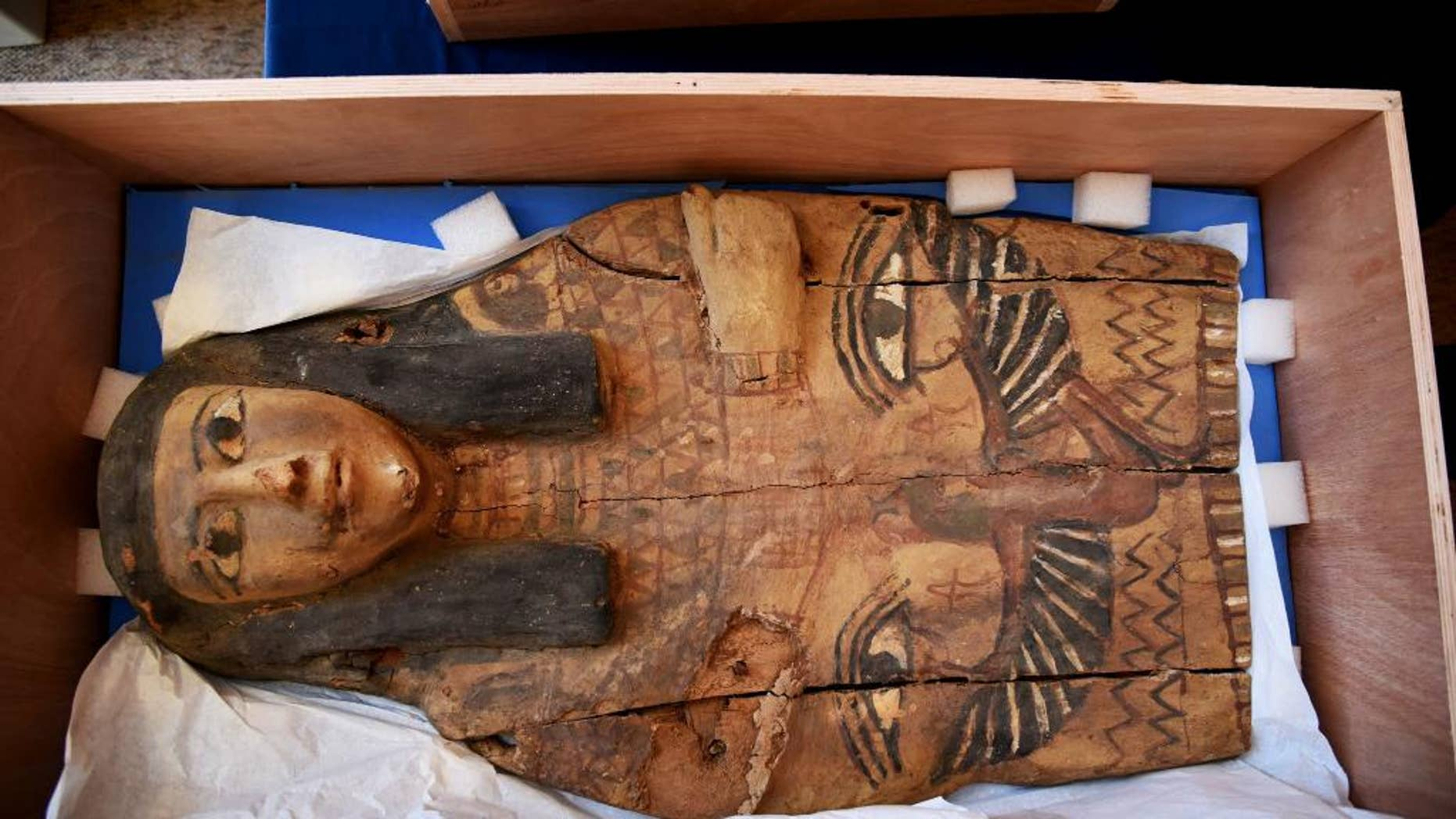 This undated photo released by the Israeli Foreign Ministry shows a part of sarcophagus cover in Israel. Israel's Antiquities Authority says the colorful sarcophagus covers date back as early as the 16th and 10th centuries BCE. It says they were shipped from Egypt to Dubai and later from London to Israel. Israeli officials discovered the in 2012 in an antiquities dealer's store in Jerusalem's Old City. (Israeli Foreign Ministry via AP)