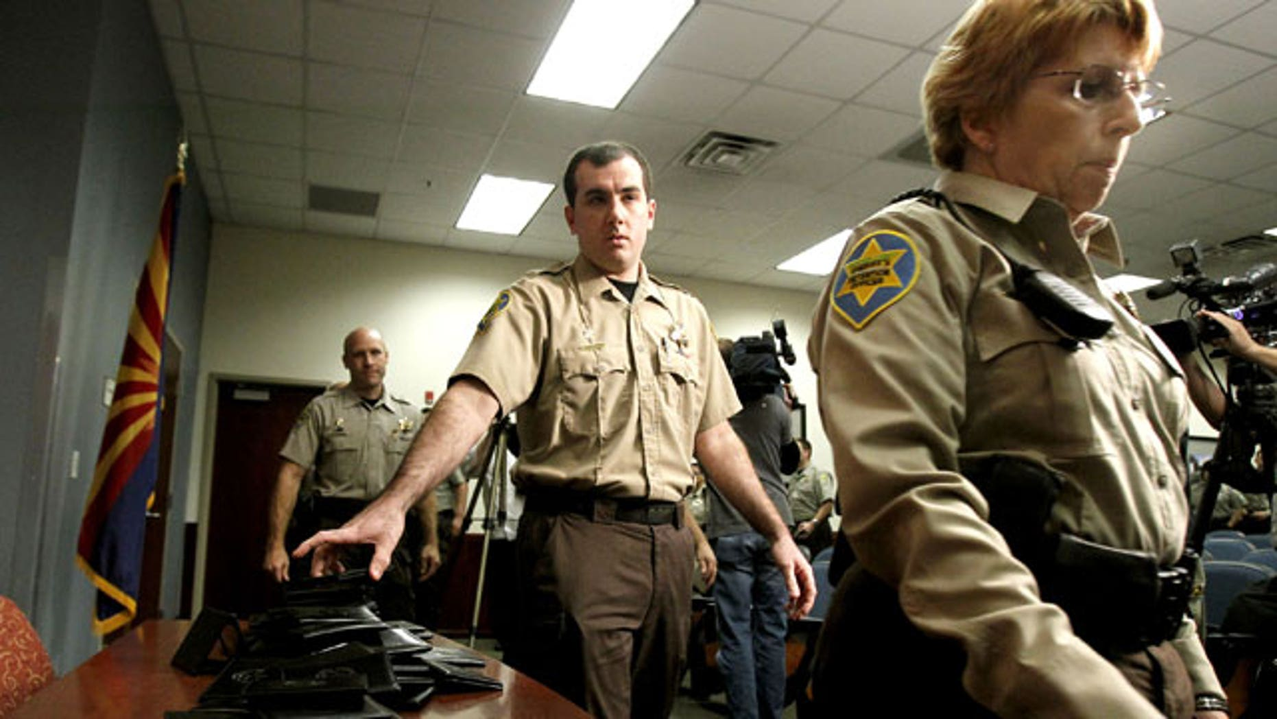 December 21, 2011: Maricopa County Sheriff's Office immigration jail officers turn in their credentials after federal officials pulled the Sheriff's office immigration enforcement powers.