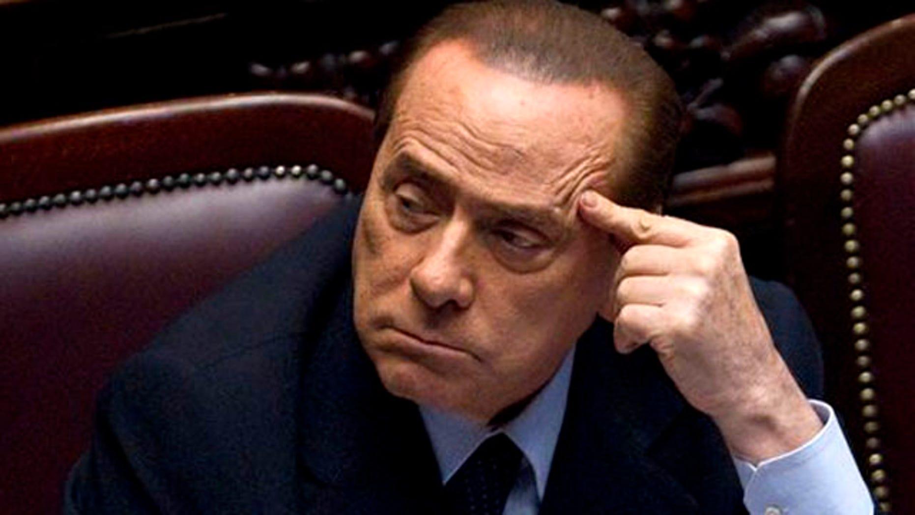 Italian Premier Silvio Berlusconi votes over a crucial austerity package.