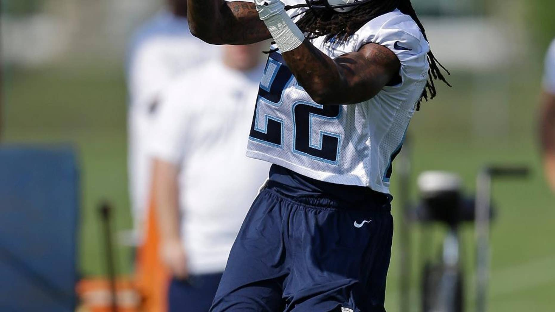 Tennessee Titans running back Dexter McCluster runs a drill during an NFL football training camp Saturday, July 26, 2014, in Nashville, Tenn. (AP Photo/Mark Humphrey)