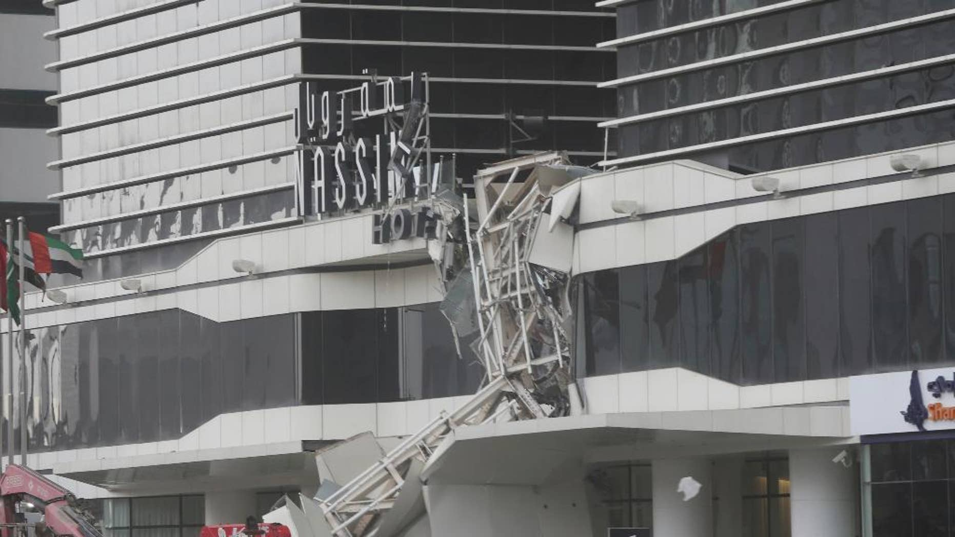 A construction crane has collapsed during high winds on the main highway running through Dubai, disrupting traffic in the heart of the Mideast's commercial hub in Dubai, United Arab Emirates, Friday, Feb. 3, 2017. (AP Photo/Kamran Jebreili)