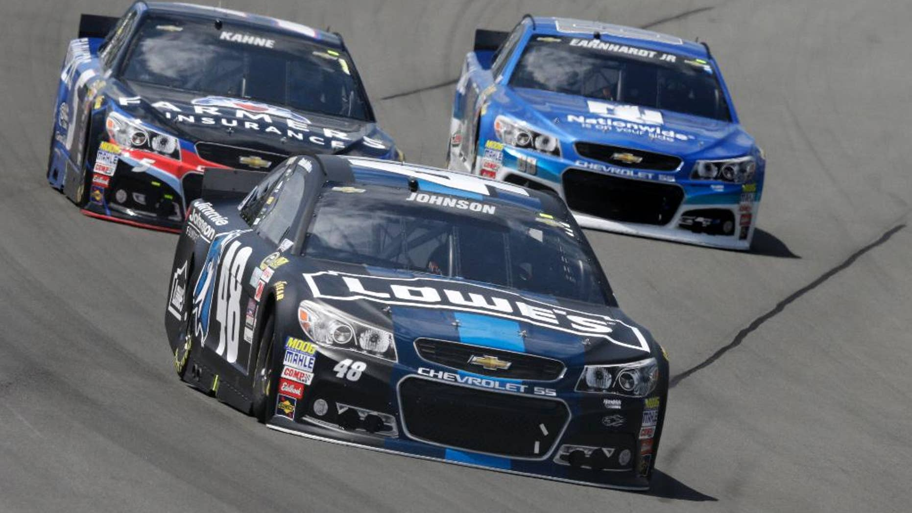 Jimmie Johnson (48) leads Dale Earnhardt Jr. (88) and Kasey Kahne (5) through Turn 3 during a NASCAR Sprint Cup Series auto race at Pocono Raceway in Long Pond, Pa., Sunday, June 7, 2015. (AP Photo/Mel Evans)