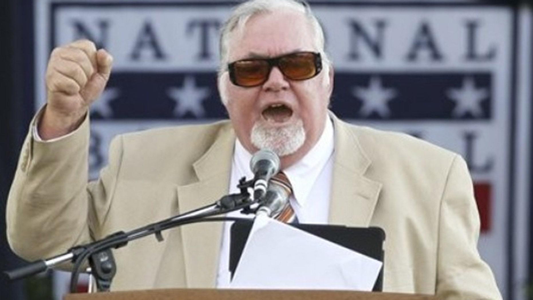 July 23, 2011: Longtime Philadelphia sports writer Bill Conlin speaks after receiving the J.G. Taylor Spink Award during a ceremony at Doubleday Field in Cooperstown, N.Y.