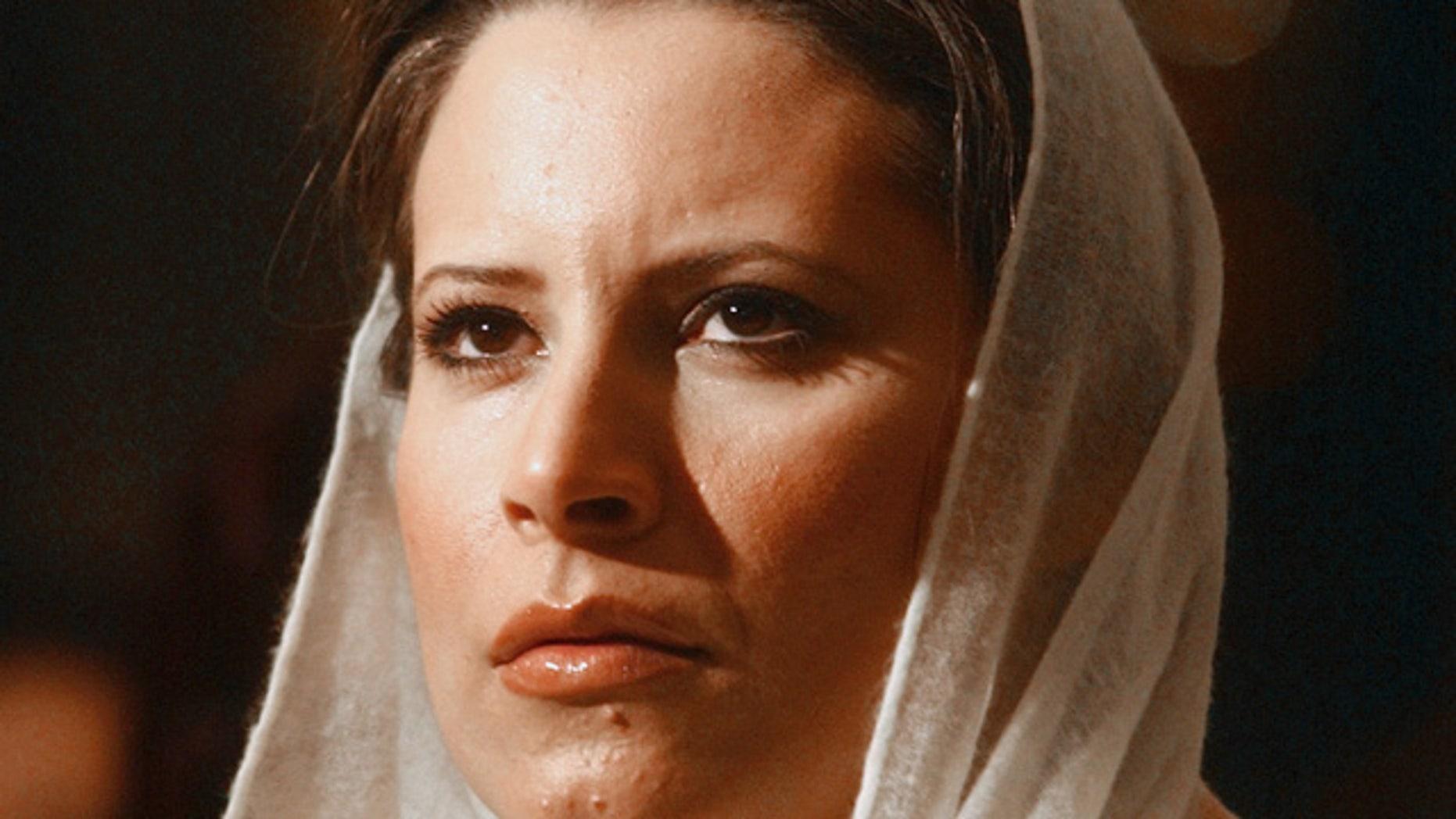 FILE 2005: Aisha Qaddafi, the daughter of Libyan leader Moammar Qaddafi, looks on before making a speech on the achievement of Libyan women in Cairo.