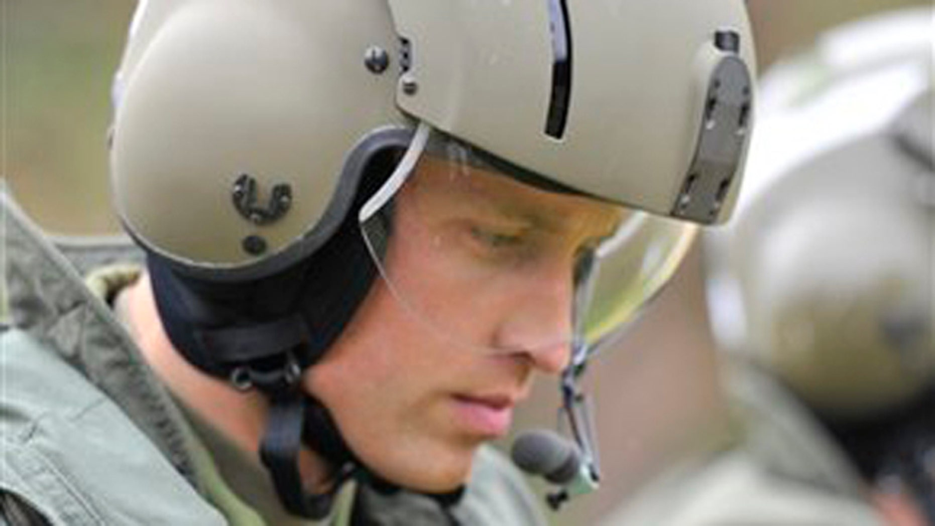 In this July 4, 2011 file photo, Britain's Prince William heads toward a Sea King helicopter for a training exercise, in Dalvay-by-the-Sea, Prince Edward Island, Canada. Prince William joined a frantic rescue mission Sunday after a cargo ship sank in the Irish Sea, leaving several crew members still missing.