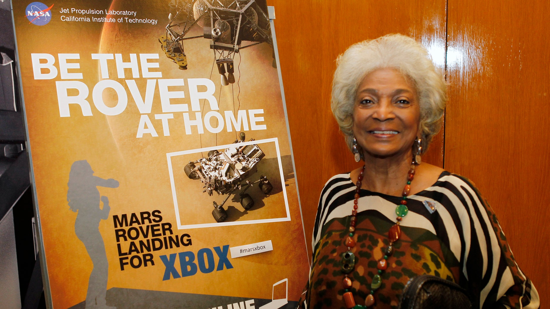 """August 5, 2012. Actress Nichelle Nichols, who played the character Uhura in the original """"Star Trek"""" TV series, poses at NASA's Jet Propulsion Lab in Pasadena, California."""