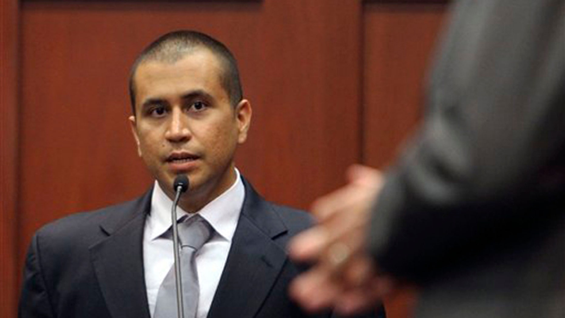 April 20, 2012: In this file photo, George Zimmerman, left, answers a question from attorney Mark O'Mara during a bond hearing in Sanford, Fla. (AP)