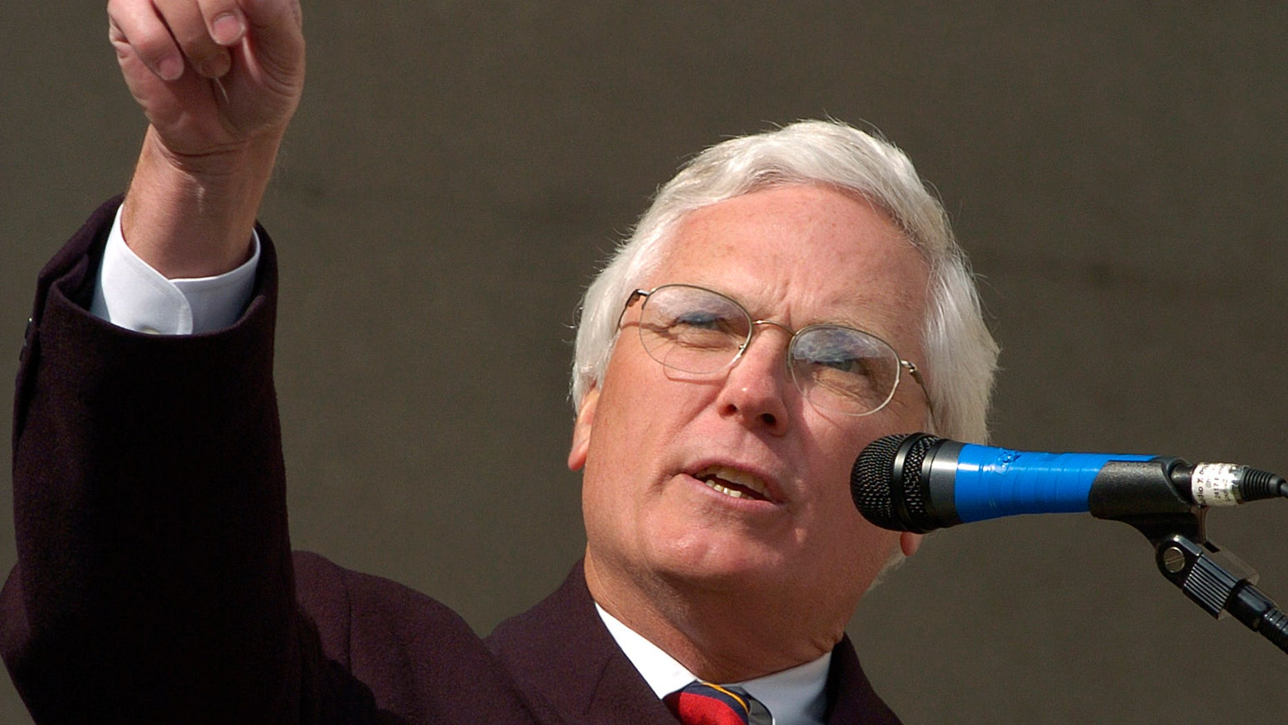 Former Jefferson County and District Court Judge Michael O'Connell gestures towards the Jefferson County Courthouse during a rally Sunday April 24, 2005 at  in Louisville, Ky. The rally was held to counter the Justice Sunday rallies held today. (AP Photo/Timothy D. Easley)