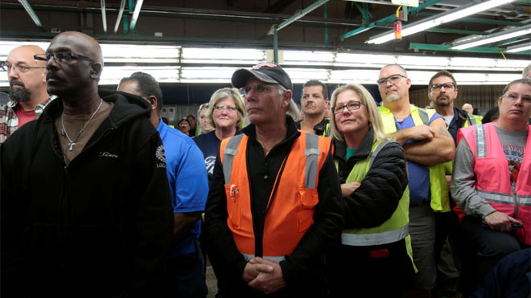 FILE: Ford Motor Co. assembly workers listen during a news conference at an assembly plant in Flat Rock, Michigan.