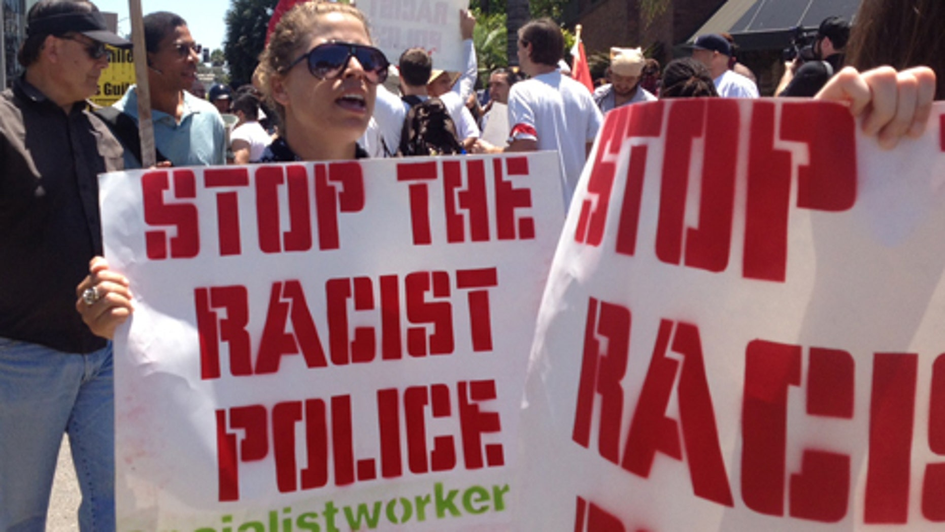 July 29: More than 300 demonstrators rallied Sunday to denounce two fatal police shootings and to issue a call for community peace. (AP Photo/The Orange County Register, Stuart Palley)