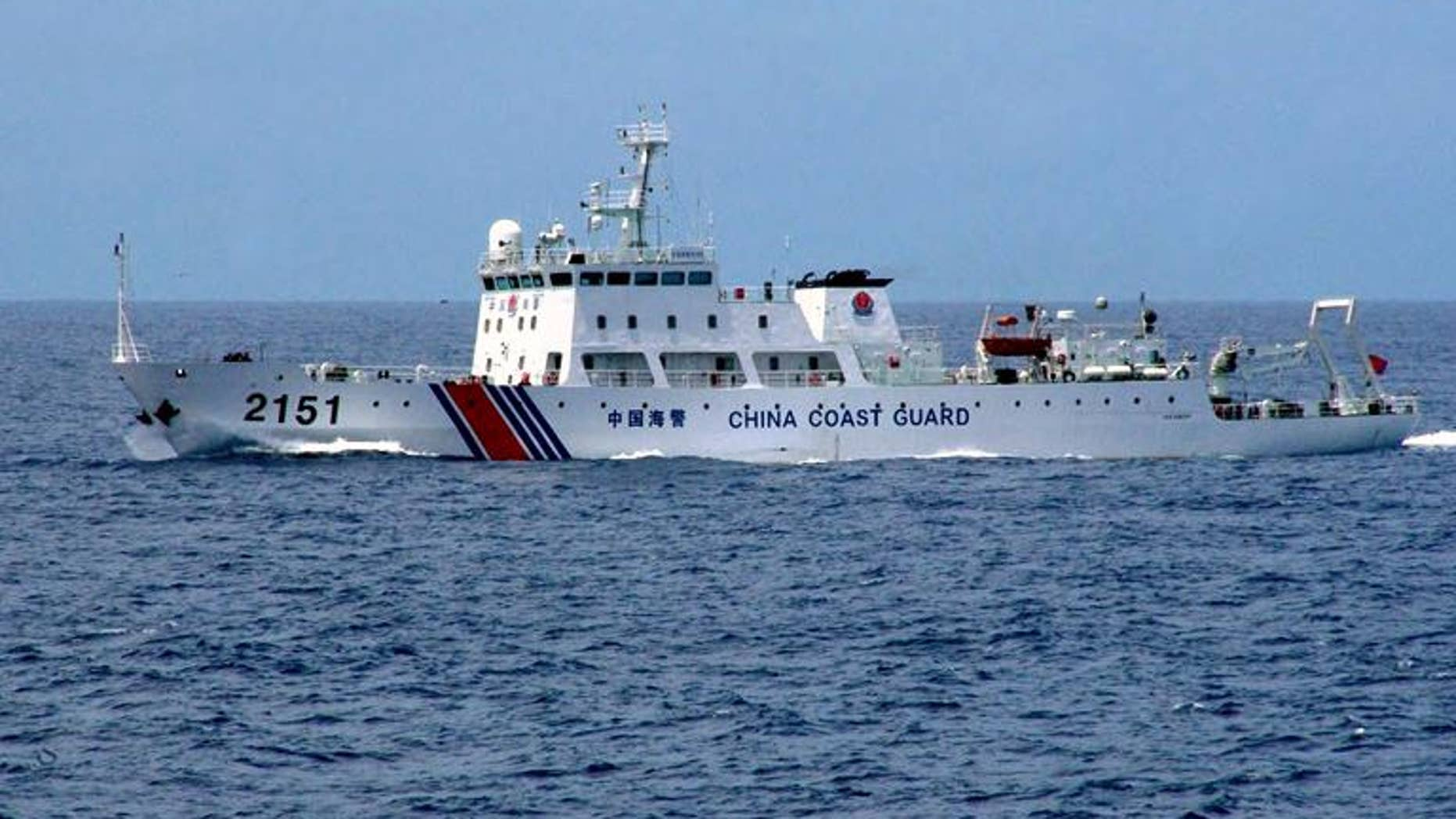 A Chinese Coast Guard ship near disputed islets, in a handout picture by the Japanese Coastguard, taken on August 13, 2013
