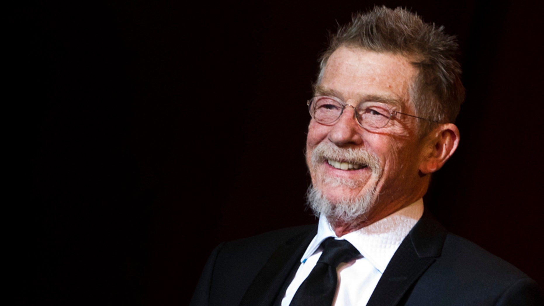 British actor John Hurt arrives on stage as a patron of the Shooting Star award, a prize for the ten most promising young European actors, at the 62th Berlinale International Film Festival in Berlin February 13, 2012.  REUTERS/Thomas Peter (GERMANY - Tags: ENTERTAINMENT) - RTR2XSV1