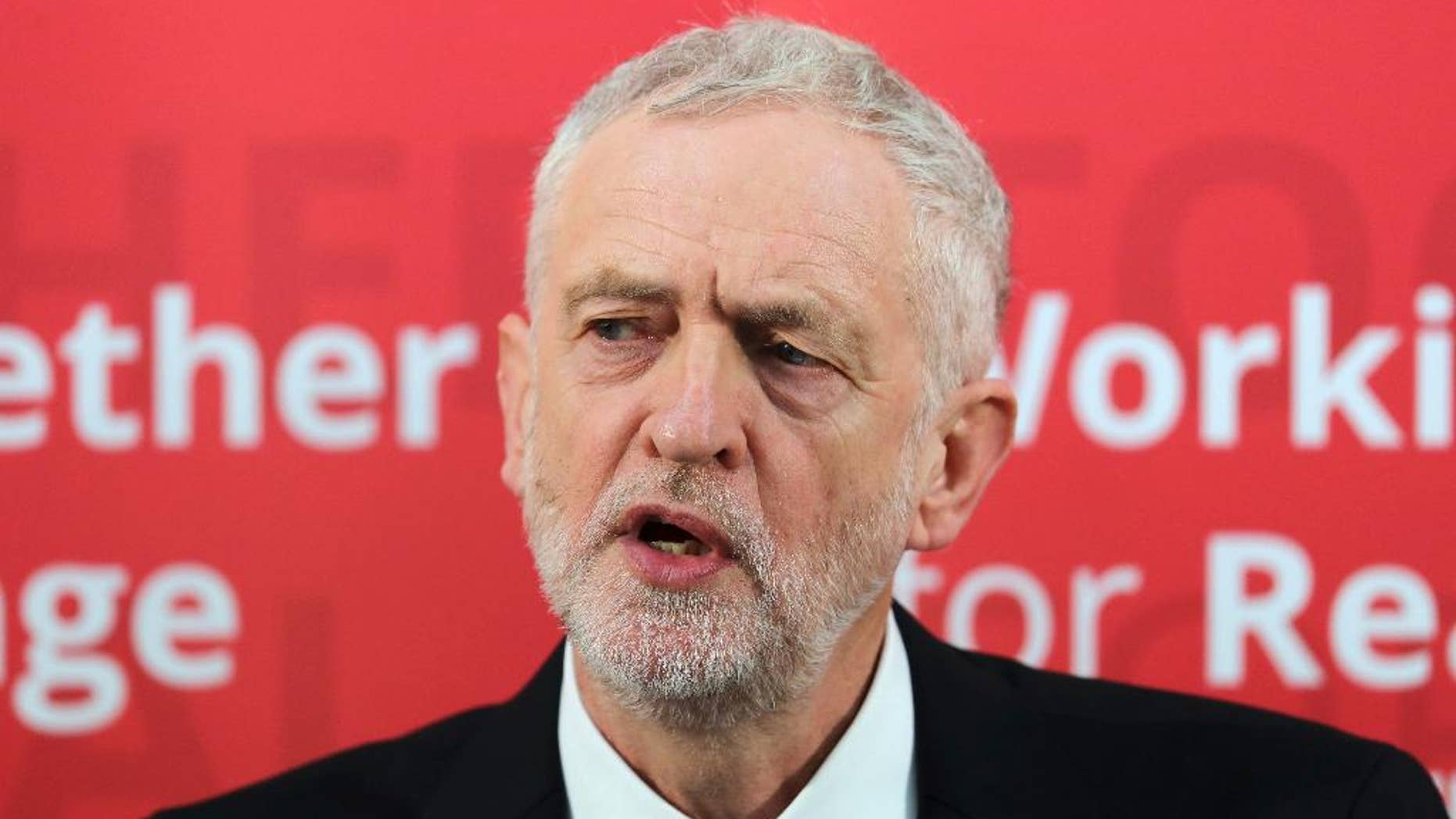 """Labour Party leader Jeremy Corbyn speaks during a visit to Paston Farm Centre in Peterborough,  England where he outlined the party's plan for Brexit and vision for Britain. Tuesday Jan. 10, 2017.  Corbyn  Britain's main opposition leader, seeking to start the year with new political momentum, has suggested imposing a national maximum wage.  Corbyn told the BBC Tuesday that """"I would like to see some kind of high-earnings cap"""" to reduce inequality. (Chris Radburn/PA via AP)"""