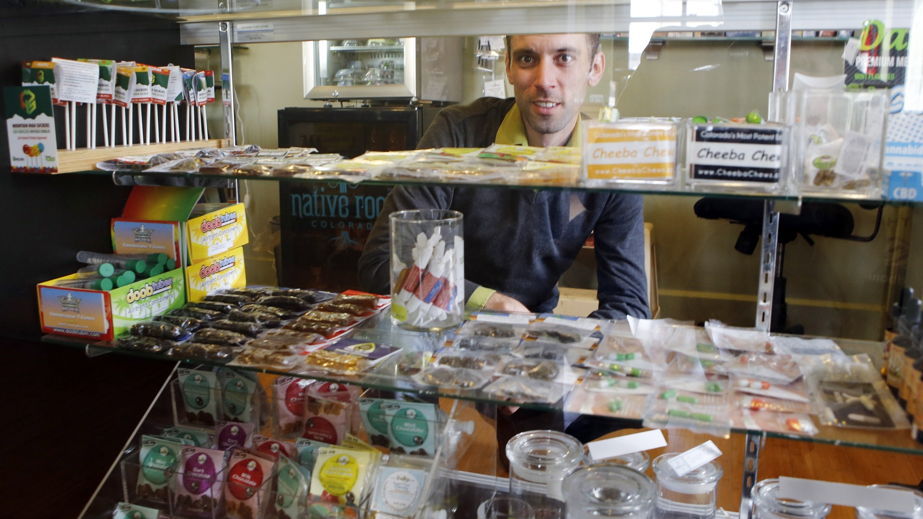 "April 11, 2013: Matt Brown, co-owner of Denver's new ""My 420 Tours,"" looking over a sampling of marijuana edibles  at a dispensary in Denver."