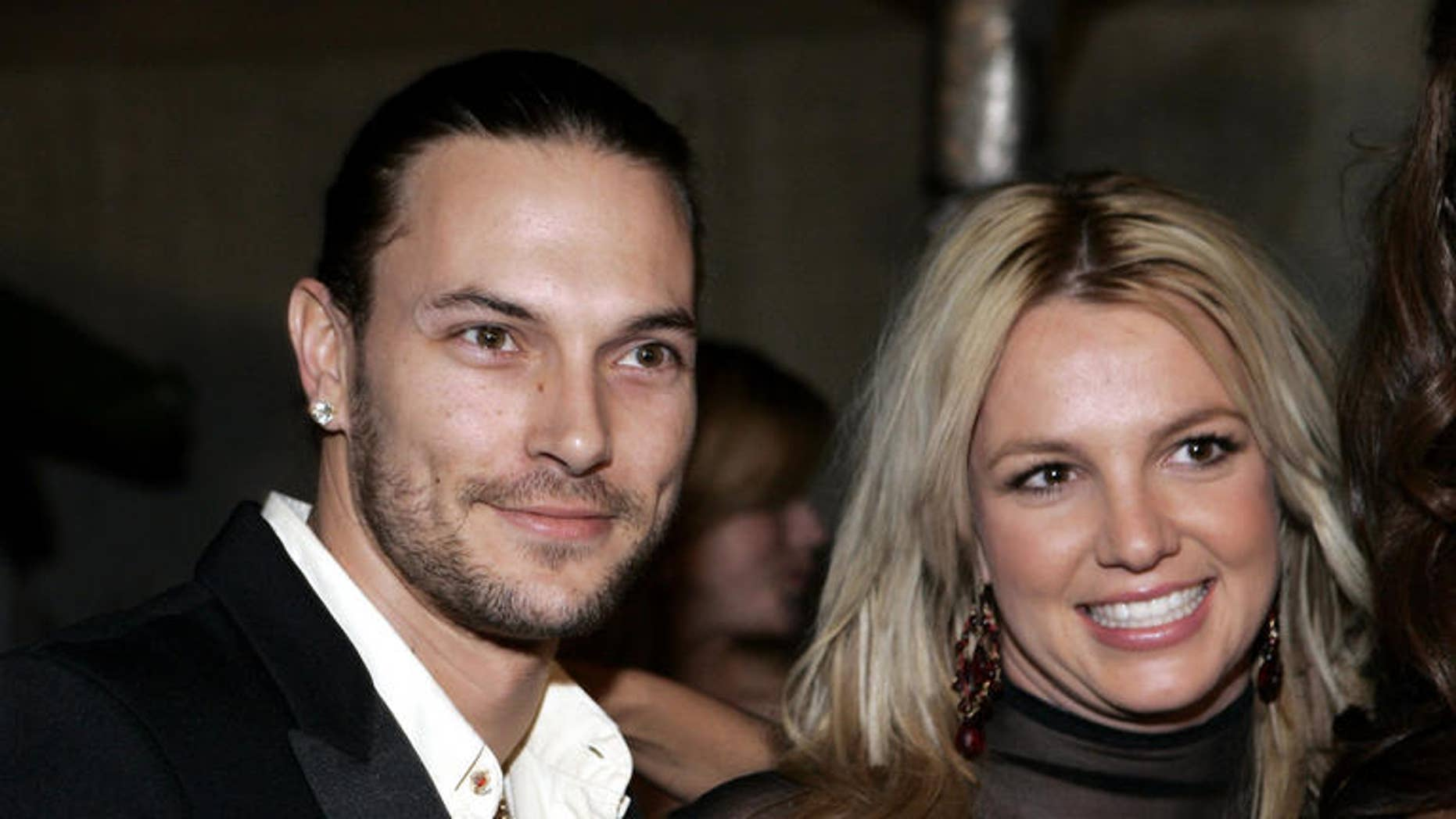 """**FILE** Britney Spears, right, and her husband Kevin Federline are seen in this Feb. 8, 2006 file photo in Beverly Hills, Calif.  Britney Spears' marriage to Kevin Federline officially ended Monday, July 30, 2007. """"They are divorced,"""" the pop star's attorney, Laura Wasser, said after a Superior Court hearing. """"Everything is finalized."""" (AP Photo/Danny Moloshok, FILE)"""