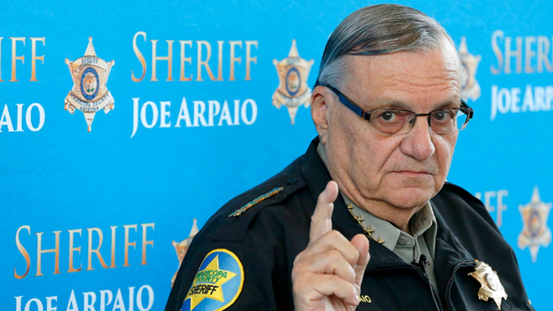 FILE - In this Dec. 18, 2013, file photo, Maricopa County Sheriff Joe Arpaio pauses as he answers a question at a news conference at Maricopa County Sheriff's Office Headquarters in Phoenix. County officials are holding a closed-door meeting Thursday to consider action in two lawsuits that accuse Arpaio of abusing his powers. A court is scheduled Wednesday, Dec. 3, 2014, to hear arguments in Maricopa County Sheriff Joe Arpaio's appeal of a ruling that concluded his officers have systematically racially profiled Latinos in vehicle stops. (AP Photo/Ross D. Franklin, File)