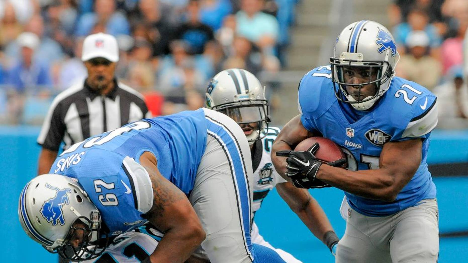 FILE - In this Sept. 14, 2014, file photo, Detroit Lions running back Reggie Bush (21) runs the ball during an NFL football game against the Carolina Panthers in Charlotte, N.C. The Lions signed Bush as a free agent before last season and  the elusive running back ran for 1,006 yards, the second-highest total of his career. But so far this season, Detroit's running game has been quiet, and that's something the Lions hope to change when they host Green Bay on Sunday.(AP Photo/Mike McCarn, File)