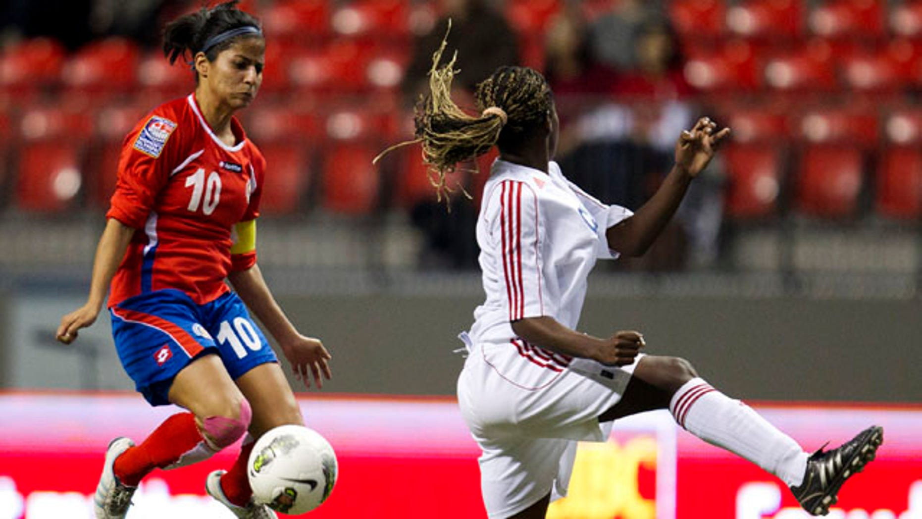 Costa Rica's Shirley Cruz (10) blocks a kick from Cuba's Jessica Alvarez Pupo, right in CONCACAF Women's Olympic qualifying soccer in Vancouver, British Columbia, Thursday, Jan. 19, 2012. Costa Rica won 2-0. (AP Photo/The Canadian Press, Jonathan Hayward)
