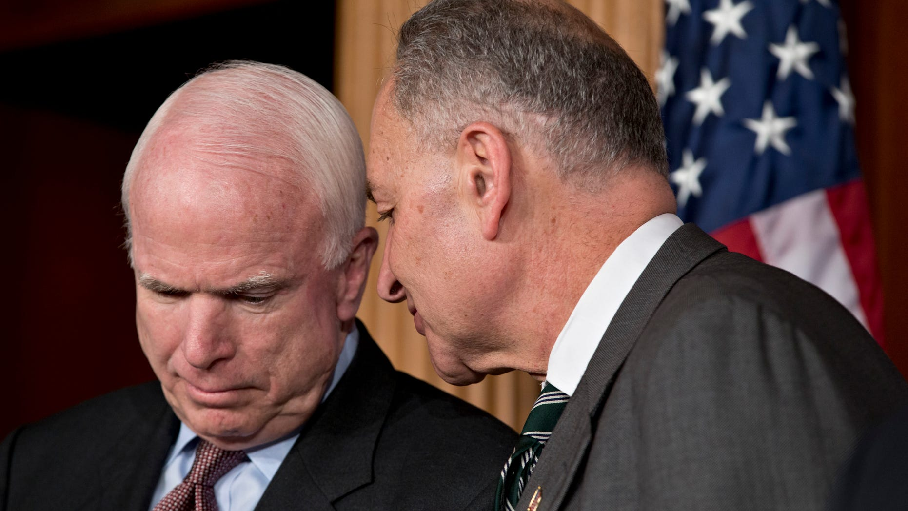 FILE:  Jan. 28, 2013: Sens. John McCain, R-Ariz., left, and Charles Schumer, D-N.Y., part of a bipartisan group of senators working on immigration reform, on Capitol Hill, in Washington, D.C.