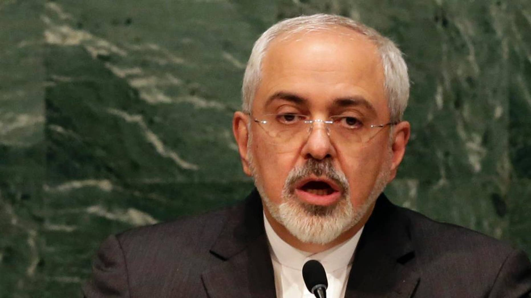 "FILE - In this April 27, 2015 file photo, Iran's Foreign Minister Mohammad Javad Zarif addresses the 2015 Nuclear Nonproliferation Treaty (NPT) review conference, in the United Nations General Assembly.  Britain has told a U.N. panel of experts that it is aware of an ""active Iranian nuclear procurement network"" linked to two Iranian companies.  The report comes as world powers negotiate with Iran on a possible comprehensive agreement on its nuclear program by June 30. (AP Photo/Richard Drew)"