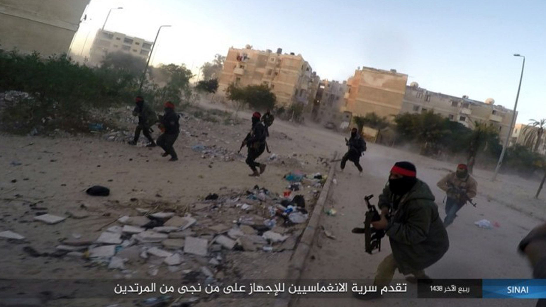 his photo posted on a file sharing website Wednesday, Jan. 11, 2017, by the Islamic State Group in Sinai, a militant organization, shows a deadly attack by militants on an Egyptian police checkpoint, in el-Arish, north Sinai, Egypt.