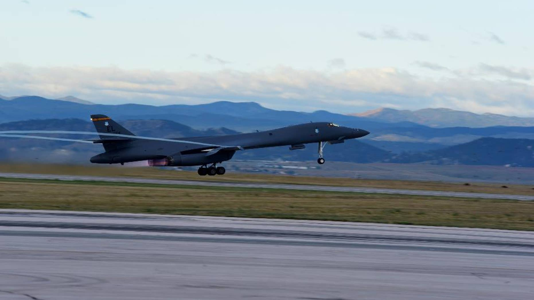 A U.S. Air Force plane takes off from Ellsworth Air Force Base for the first training mission in the expanded Powder River Training Complex over the northern Plains, Friday, Sept. 18, 2015, in South Dakota. The expansion of the Powder River Training Complex over the Dakotas, Montana and Wyoming roughly quadruples the training airspace to span nearly 35,000 square miles, making it the largest over the continental U.S. Flight operations began after the Federal Aviation Administration finished mapping work on the expanded airspace, a spokeswoman for the 28th Bomb Wing at Ellsworth Air Force Base said. (Airman 1st Class James Miller/U.S. Air Force via AP)