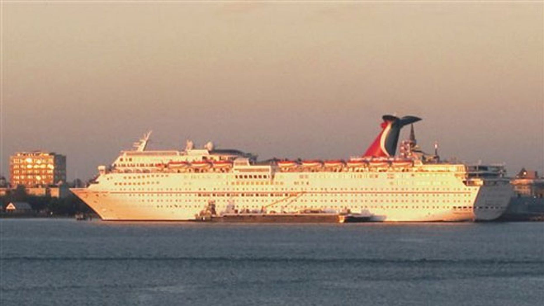 FILE: The Carnival Fantasy rests at its berth just after dawn in Charleston, S.C. South Carolina regulators on Tuesday approved a needed permit for the South Carolina State Ports Authority to build a new $35 million cruise passenger terminal.