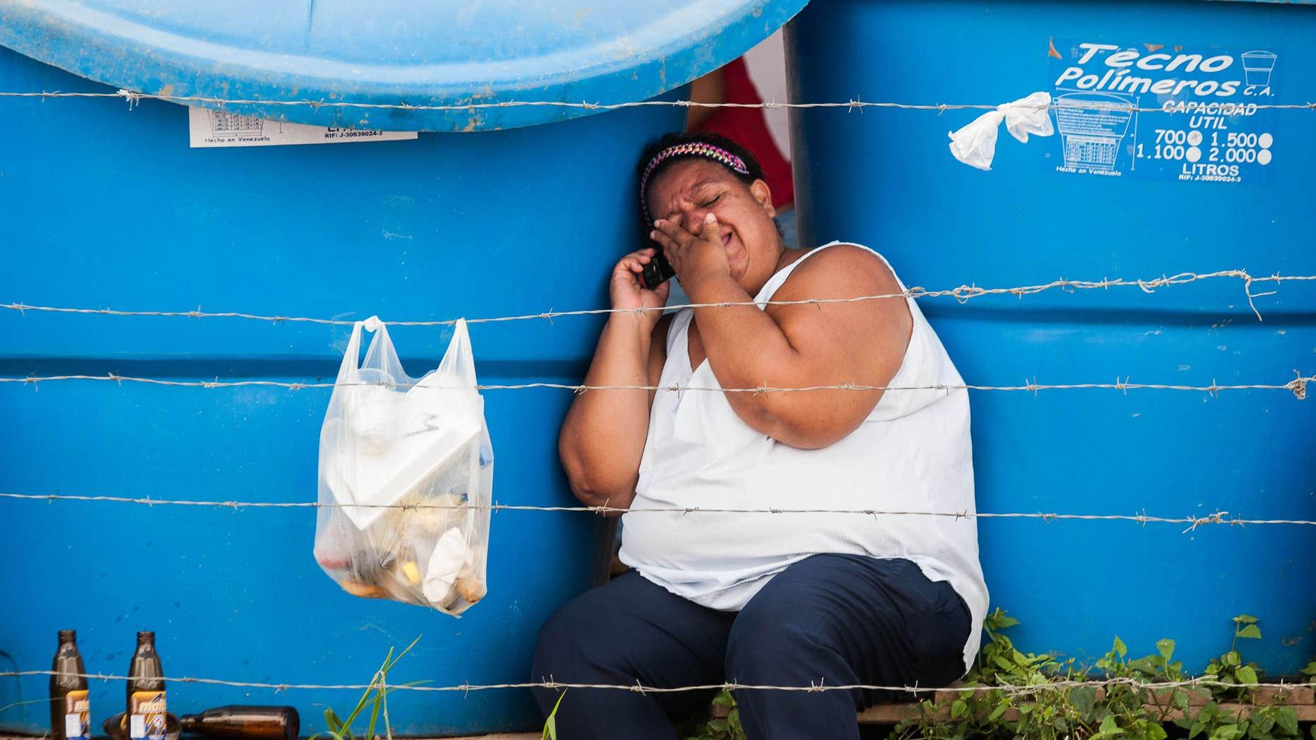 A relative of a inmate cries outside the David Viloria prison in Barquisimeto, Venezuela, Thursday, Nov. 27, 2014.