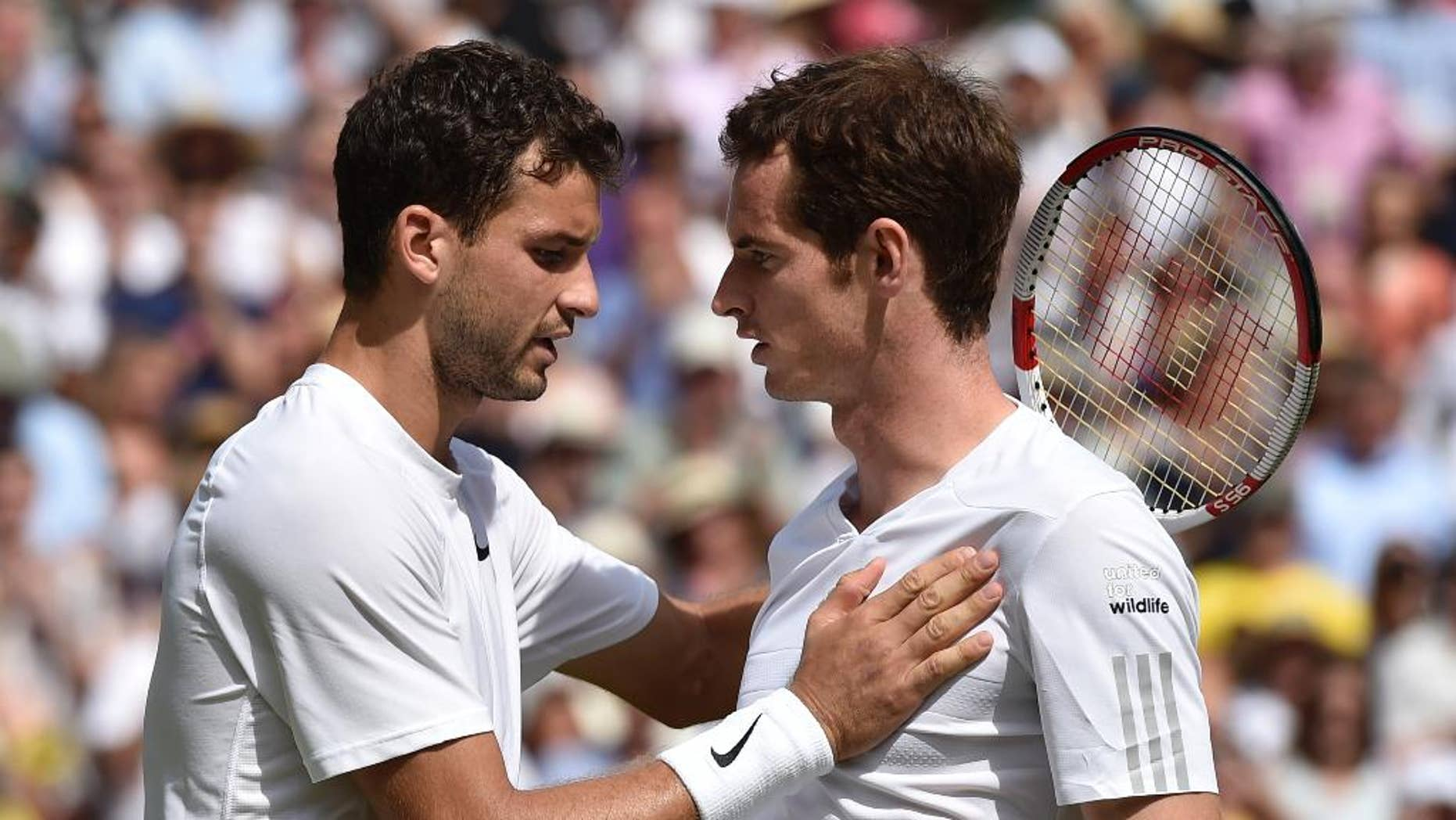 Grigor Dimitrov of Bulgaria, left, is congratulated by defending champion Andy Murray of Britain after winning their men's singles quarterfinal match at the All England Lawn Tennis Championships in Wimbledon, London, Wednesday July 2, 2014. (AP Photo/Toby Melville, Pool)