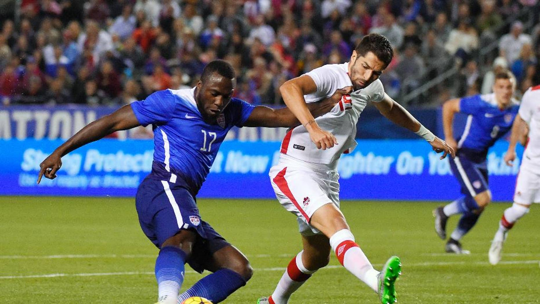 FILE - In this Friday Feb. 5, 2016, file photo, United States' Jozy Altidore, left, tries to shoot at goal as Canada's Steven Vitoria vie defends during the first half of an exhibition soccer match in Carson, Calif. Altidore appears certain to miss the Copa America Centenario following yet another hamstring injury. Altidore, who hasn't scored for Toronto in Major League Soccer this season, got hurt Saturday, May 14, 2016, while taking a penalty kick against Vancouver that was saved. Toronto said Monday the 26-year-old will be sidelined for six-to-eight weeks. (AP Photo/Mark J. Terrill, File)