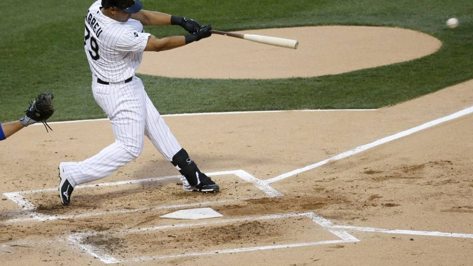 Chicago White Sox's Jose Abreu hits a single off Chicago Cubs starting pitcher Jake Arrieta during the first inning of an interleague baseball game Thursday, May 8, 2014, in Chicago. (AP Photo/Charles Rex Arbogast)