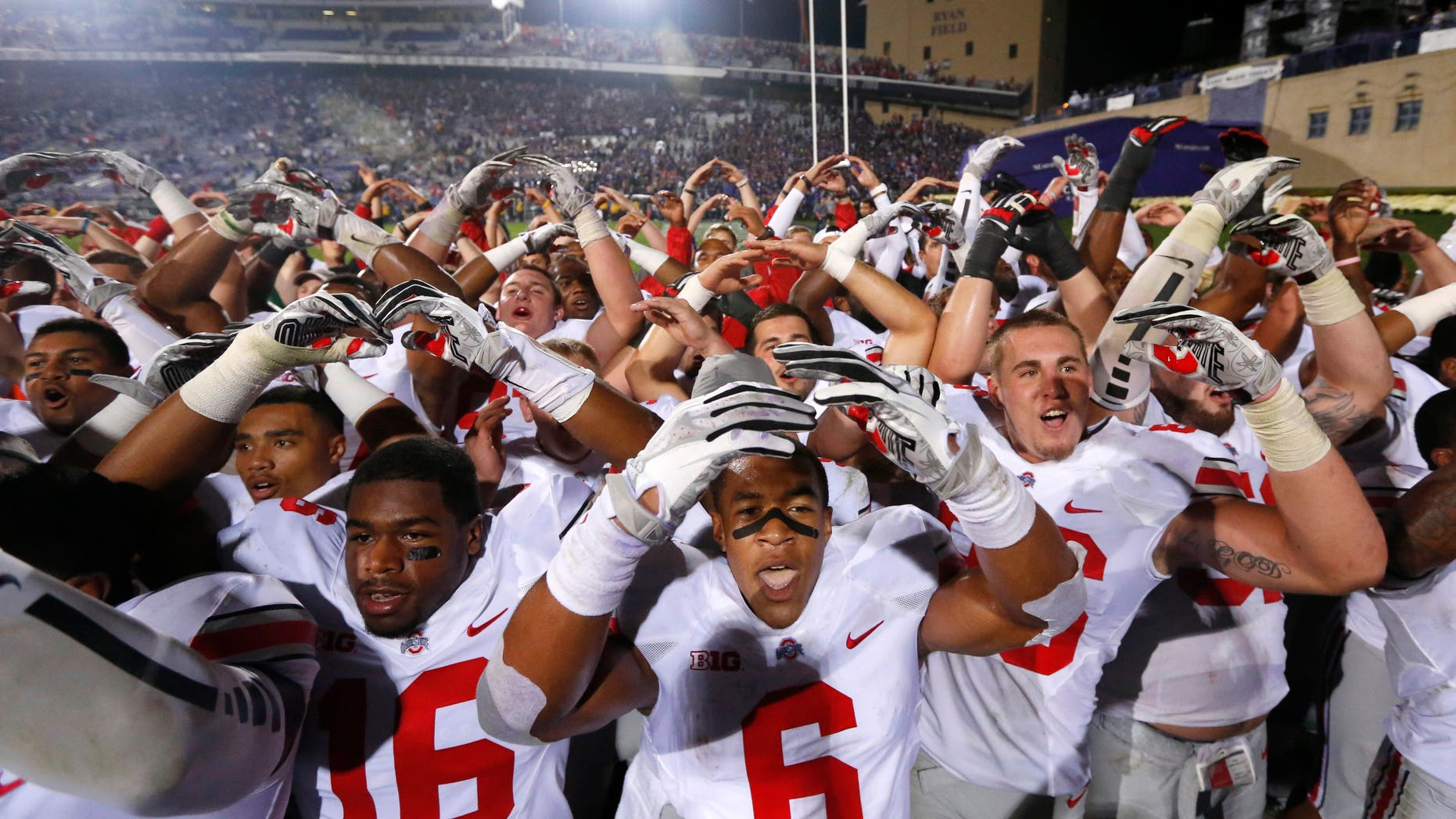 FILE-In this Saturday, Oct. 5, 2013 file photo shows The Ohio State Buckeyes celebrating a 40-30 win over Northwestern after an NCAA football game in Evanston, Ill. Over its bye week, Ohio State's players and coaches had a chance to see other top teams. They came away thinking the Buckeyes could play with any of them. (AP Photo/Charles Rex Arbogast, File)